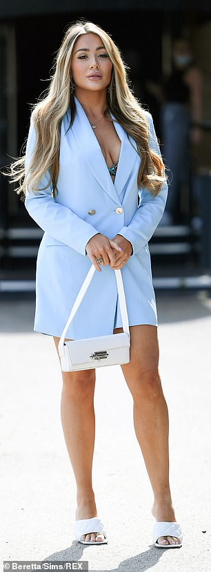 Stunning: Frankie set pulses racing as she slipped into a powder blue oversized blazer, giving a glimpse of her blue bra underneath