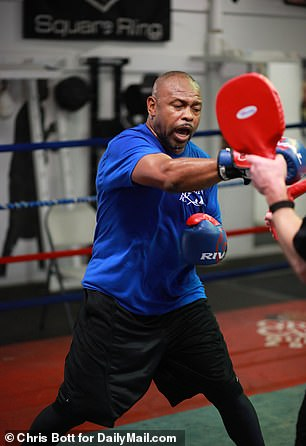 'I've still been training every day. I'm ready,' Jones said of his upcoming fight against Mike Tyson wiht his brow dripping with sweat after completing a session with his trainer
