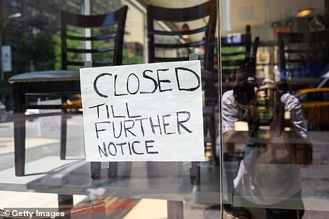 A sign is posted at a restaurant on July 28. More than 1,000 have been forced to close permanently