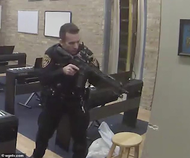 A lawyer for the Wilder family said the cop was armed with his personal military-style assault rifle (pictured)