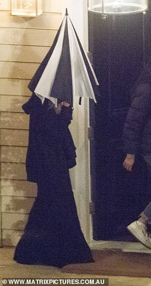 Who could it be? One other contestant was pictured arriving in a black gown