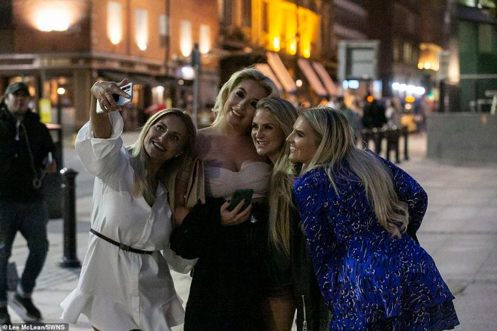People can be seen in Manchester City centre tonight, enjoying the last weekend before lockdown restrictions are tightened in England