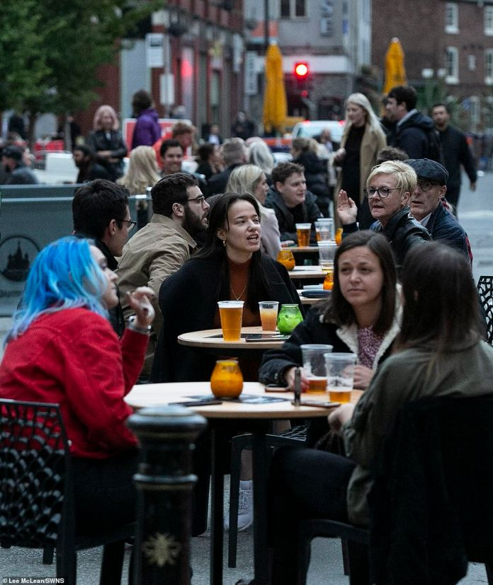 Elsewhere in Manchester, groups sat together as they enjoyed a pint outside a bar in the city