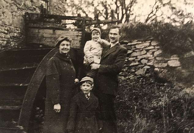 Grant, pictured with with his father, Rex, right, mother, Audrey, left, and his older brother Richard, in 1957 in Belfast