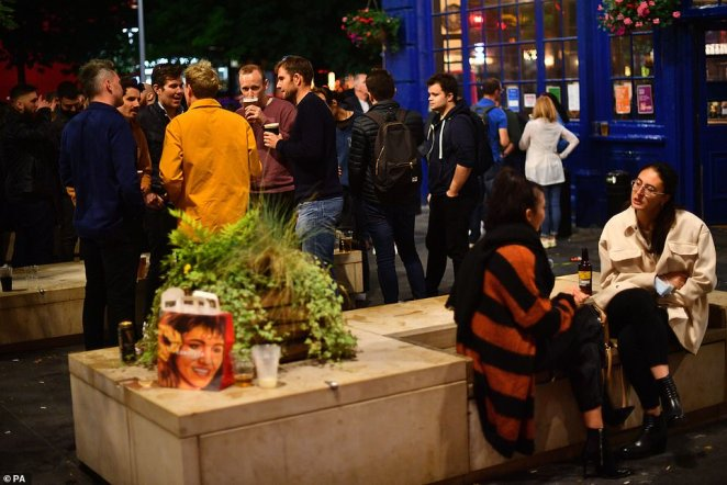 People gather outside the The Shipwrights Arms near London Bridge on Friday for a final weekend of freedom out before the new rules hit