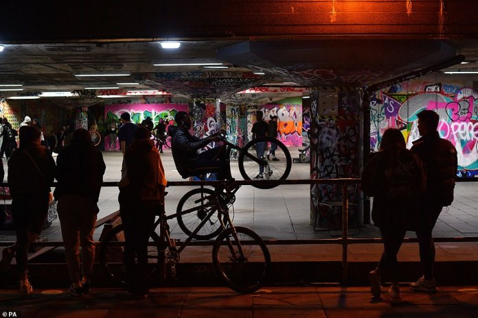 People gather at the Southbank Skatepark in Waterloo, London ahead of the new rules, which ban groups of more than six