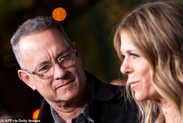 An extraordinary row has erupted after Hollywood actor Tom Hanks (pictured left with wife Rita Wilson right) was granted a special exemption to enter Queensland on Tuesday