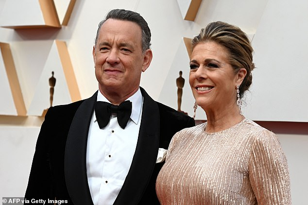 Mr Hanks (pictured left with wife Rita) is filming an Elvis Presley biopic on the Gold Coast