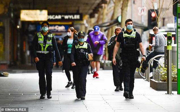 Mr Andrews admitted on Wednesday he introduced Melbourne's overnight curfew to make it easier for police to enforce lockdown. Pictured: Police patrolling a mall strip during the city's COVID-19 lockdown