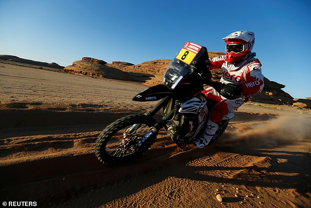 Price (pictured at the Dakar Rally) came across Portuguese racer Paul Goncalves crashed in the Saudi Arabian desert and attempted to perform CPR to revive the 40-year-old