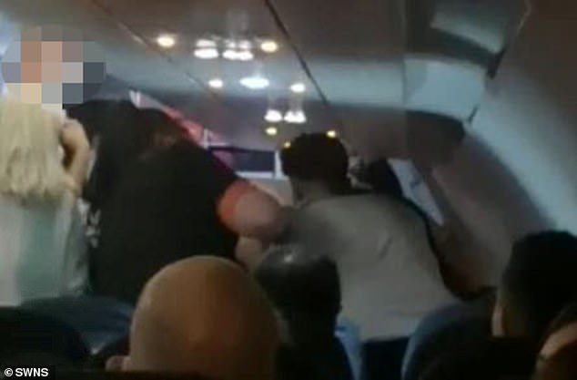 It is unclear whether the man's punch connected with the victim or if it hit the chair in front