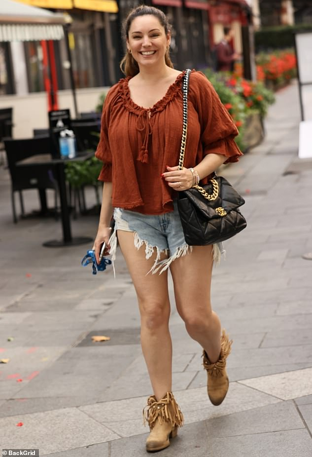 Details: Kelly teamed the item of clothing with a burnt copper ruffled top with tassels on the neckline