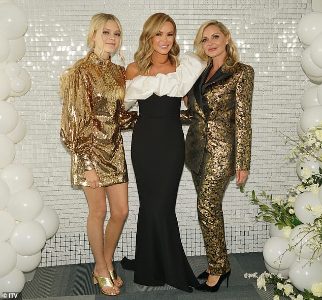 Women power:Honey shined bright in a sequin smock dress and gold sandal heels whileSammy cut a stylish figure in a tuxedo suit featuring a black and gold baroque pattern