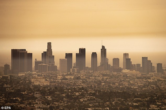 A view of downtown Los Angeles under an orange overcast sky in the afternoon in Los Angeles on Thursday