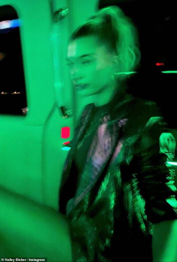 City Nights: Hailey posted an artificially blurred shot with green backlighting as she and her husband left Delilah
