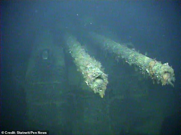 Footage of the Karlsruhe, found 490 meters below sea level, shows the ship upright with cannons pointing into the sea (pictured)