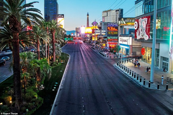 ALMOST DESERTED: The entertainment mecca of the Strip, which attracted 49.5 million people in 2019 from around the world – including half a million from the UK – is neglected and deserted. Pictured: The Vegas strip lies empty on September 9
