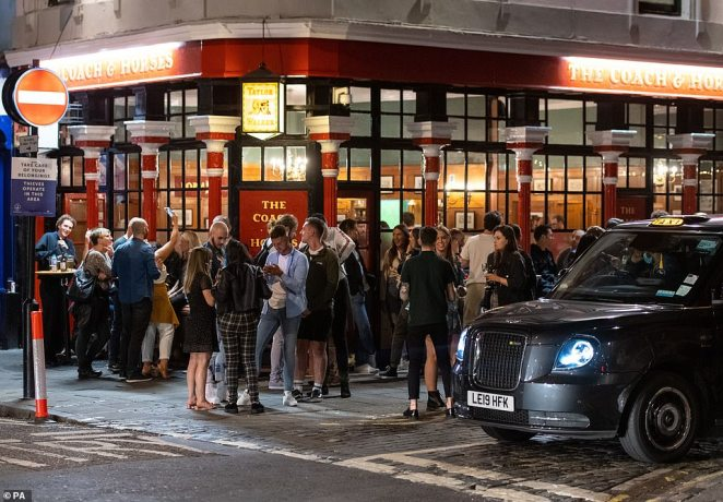 General view of people enjoying a night out in Soho, in London's West End, shortly after being warned not to have a 'party weekend' by scientific advisers
