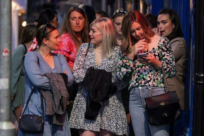 Nottingham revellers flock to city centre bars to enjoy a night out before coronavirus rules change on Monday.Crowds of people flocked to bars and pubs in the city. Long queues were seen outside a number of bars with social distancing at a minimum