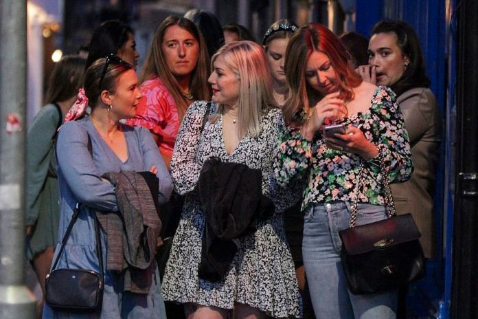 Nottingham revellers flock to city centre bars to enjoy a night out before coronavirus rules change on Monday. Crowds of people flocked to bars and pubs in the city. Long queues were seen outside a number of bars with social distancing at a minimum