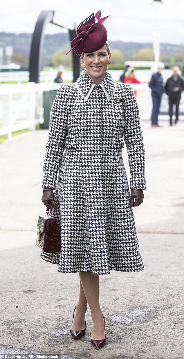 Zara Tindall at the Ladies Day Cheltenham 2020 in a Laura Green ¿Josephine¿ coat £2,900. Juliette Botterill Millinery ¿Bow and Arrow¿ hat, £490. Emmy ¿Rebecca¿ pumps £395. Laurence Coste ¿May¿ earrings £95. Aspinal of London ¿Mayfair¿ bag £650