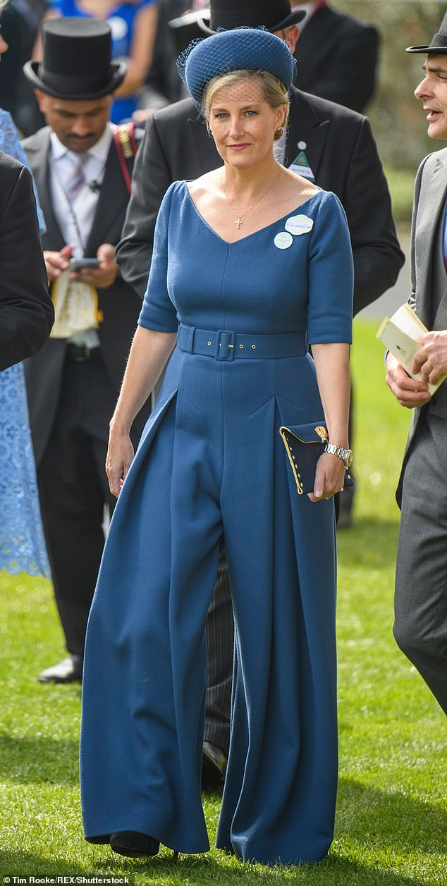 Sophie, Countess of Wessex, at Ladies Day Royal Ascot 2019 in an Emilia Wickstead ¿Hullinie¿ crepe jumpsuit¿ £1,225. Jane Taylor ¿Veil-Trimmed Halo¿ headpiece¿ £985. Beauchamps of London ¿Hutchinson¿ clutch¿ £250. LK Bennett ¿Harley¿ pumps £195