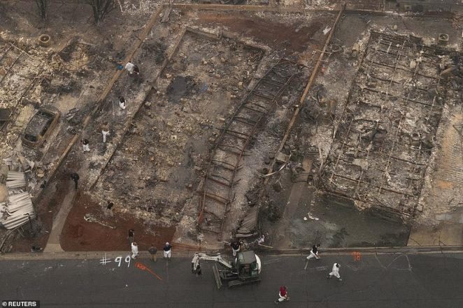 Search and rescue personnel search for the remains of fire victims in the Bear Lakes Estates neighborhood which was left devastated by the Almeda fire in Phoenix, Oregon, on Saturday