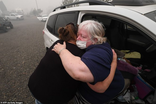 Margi Wyatt (right) is comforted by mobile home park manager Valerie after Wyatt returned to the R.V. park to find her home destroyed by wildfire in Estacada, Oregon, on Saturday