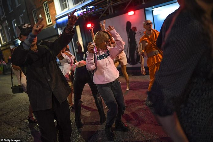 LONDON: Revellers are seen partying in the streets of Soho in London ahead of plans to bring in a ban on meetings of groups of more than six