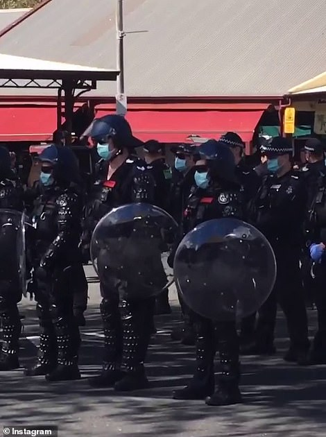 Pictured: Riot squad in protective gear