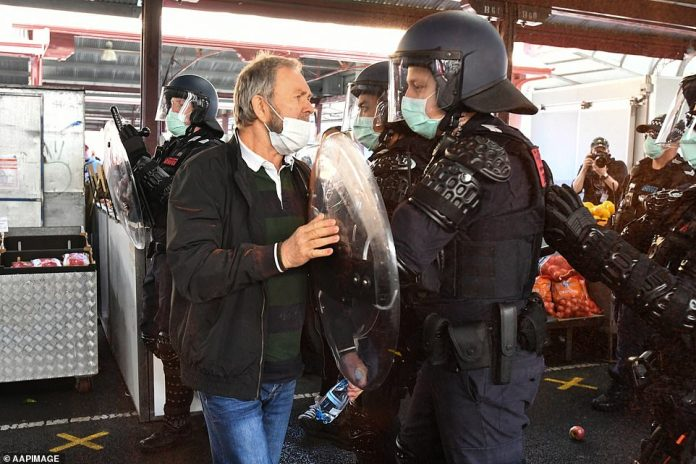 Police move protesters on during an anti-lockdown protest in Melbourne, Sunday, September 13