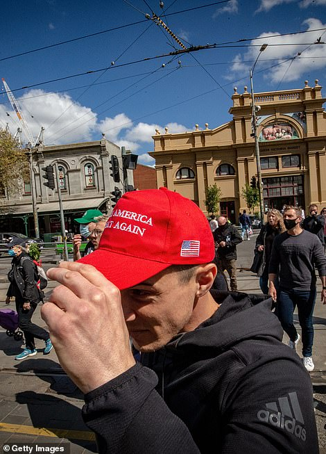 One protester wore a 'Make America Great Again' cap at the rally