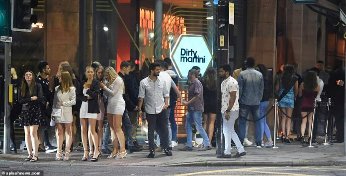 MANCHESTER: A large number of people queue to enter the Dirty Martini bar in Manchester on Saturday night