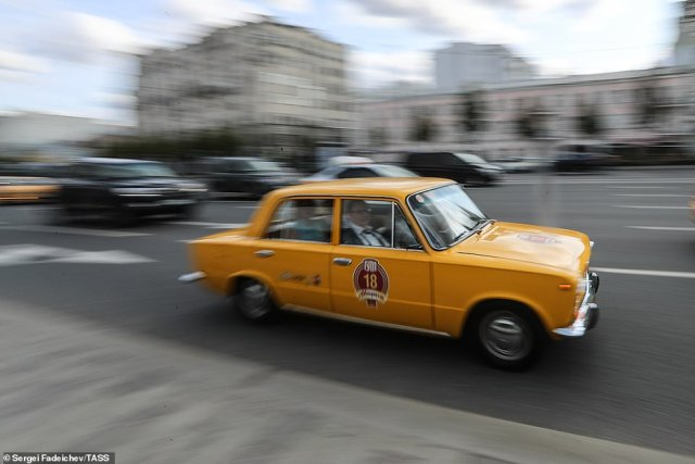 A yellow Lada speeds its way to the rally. The cars were very popular inside the Soviet Union in the 1990s