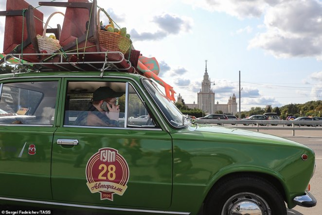 The top of this green Lada was propped with accessories, making it look as though the owner was heading off to a summer holiday