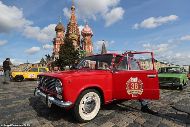 Many of the cars on show at the rally offer a glimpse into Russia's past (pictured, a red Lada with a GUM Motor Rally sticker seen in central Moscow)