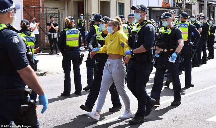 Protesters were outnumbered by a sea of police officers who flooded the scene to break-up the demonstration