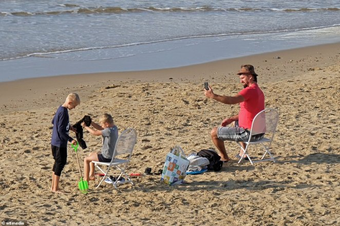 A group of people set up their chairs on Bournemouth beach along the south coast today as temperatures continue to rise