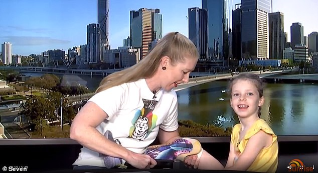 Amy Wilkinson (left) with daughter Mia, 7, on Sunrise on Sunday, showing off Mia's new running blades. Mia is doing well after losing her lower arms and legs to sepsis two years ago