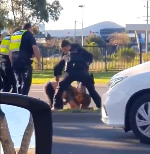 Police officers were filmed (pictured) kicking a man during a brutal arrest in Epping, in Melbourne's north, on Sunday afternoon