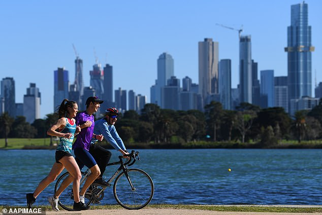 Pictured: people exercising at Albert Park Lake, Melbourne, on Friday. Step One easing means outdoors time has been increased from one hour to two hours daily