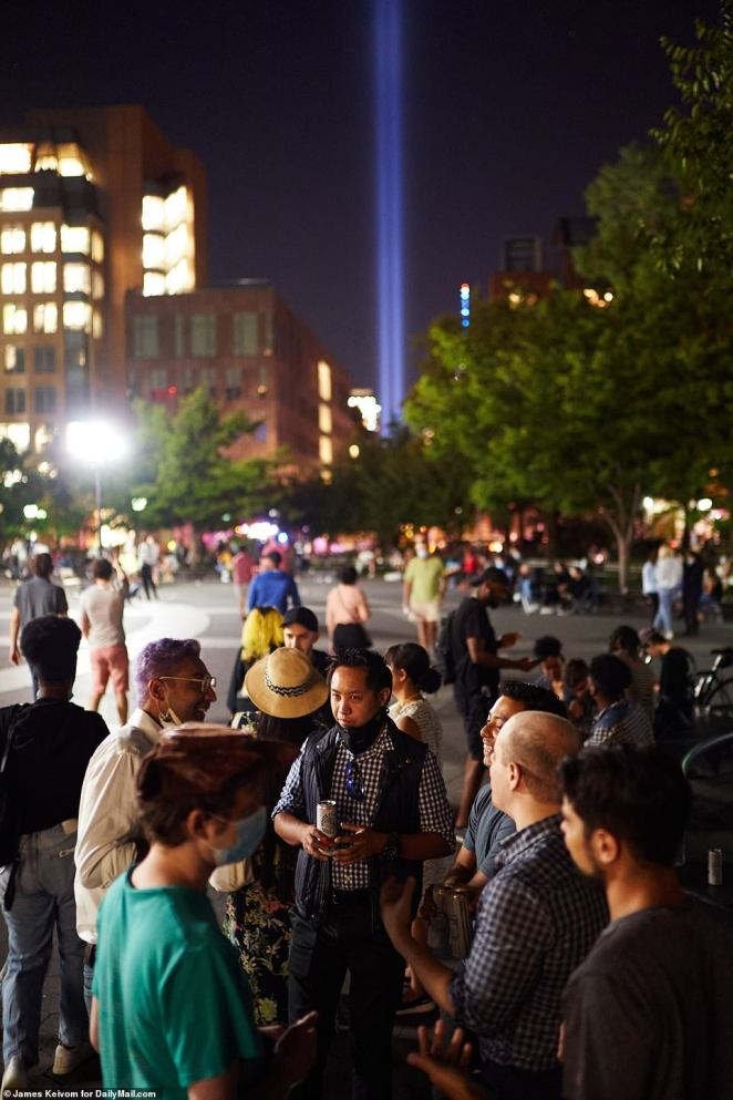 The Tribute In Light is seen in the background at the park on the 19th anniversary of the September 11, 2001 terror attacks