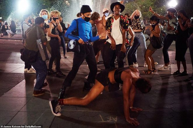 A woman is seen twerking on the ground as Friday night's festivities ramped up