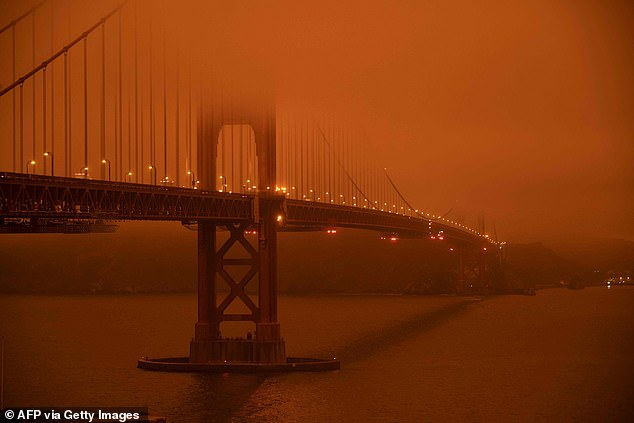 More people are leaving California than arriving, driven out by worsening wildfires, power outages, and the skyrocketing cost of living. Cars drive along the Golden Gate Bride under a haze of orange smoke in San Francisco on September 9