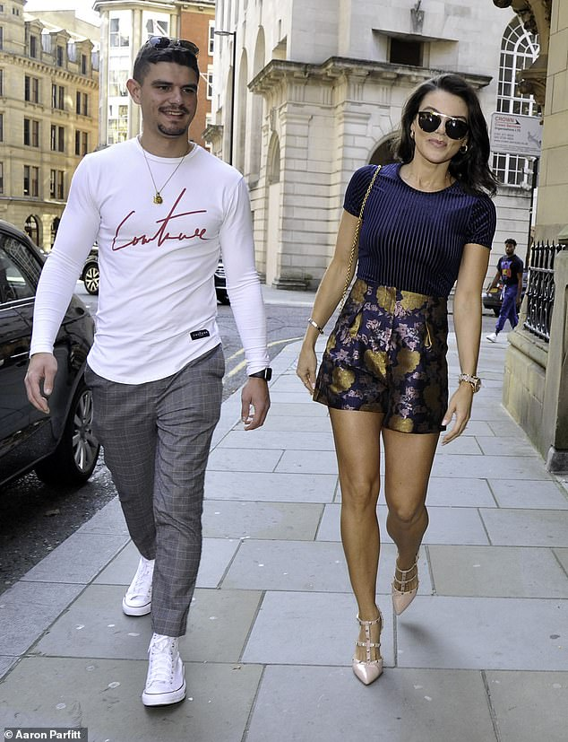 Stunning: Faye Brookes put on a leggy display in a blue and gold high-waist shorts and a navy top as she enjoyed an outing with her brother Jack in Manchester on Sunday