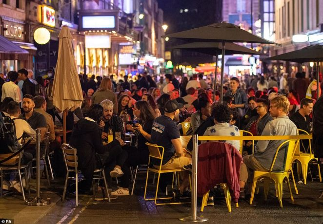 """LONDON: General view of people enjoying a night out in Soho, in London's West End. People have been warned against having a """"party weekend"""" as a former chief scientific adviser said the UK is """"on the edge of losing control"""" of coronavirus"""