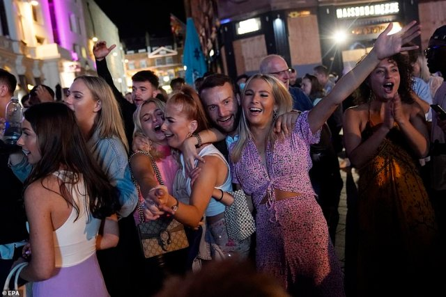 LONDON: Members of the public spend a night out in Central London, Britain tonight. The British government is due to implement new restrictions banning gatherings of six people from Monday