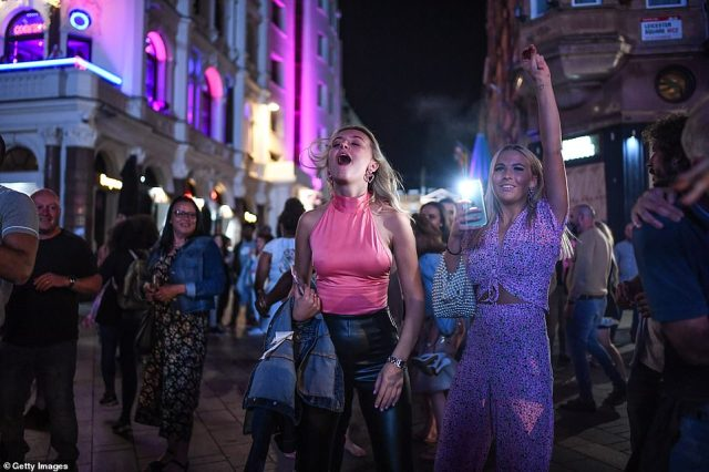 LONDON: People are seen dancing to a busker in Leicester Square tonight in London, England. From Monday, September 14, groups of more than six will be banned from meeting under new coronavirus restrictions