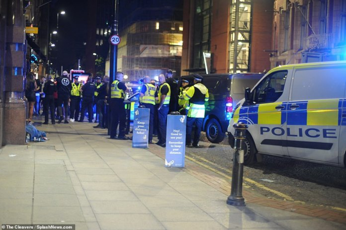 GREATER MANCHESTER: Revellers were seen not to be socially distancing as the police made a heavy presence across Manchester as party-goers let loose ahead of the new restrictions being introduced on Monday