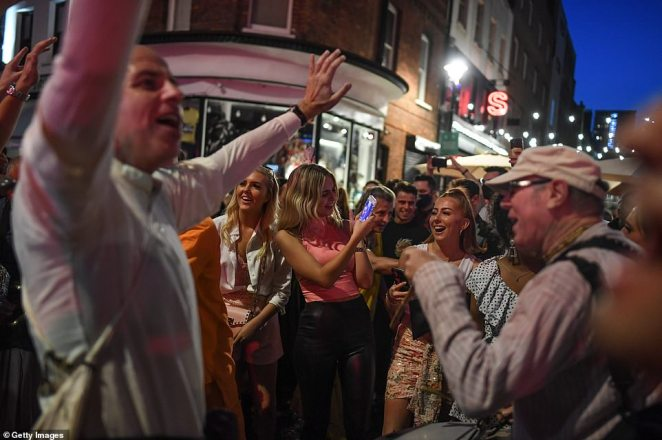 LONDON: In Soho people took to the streets of the city's famous nightlife hot-spot to enjoy one last night of freedom on Saturday night